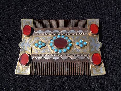 Turkoman silver comb adorned with turquoise and carnelian stones.  by Turkoman silversmith master