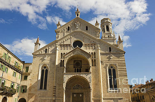 Verona Cathedral facade over blue sky with white clouds by Kiril Stanchev
