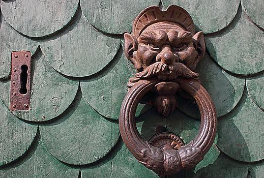 Vintage rusty door knocker in Pisa Italy by Kiril Stanchev