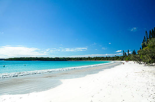 Waves lapping against white sandy beach - Kuto Bay - Isle of Pines - New Caledonia by David Hill
