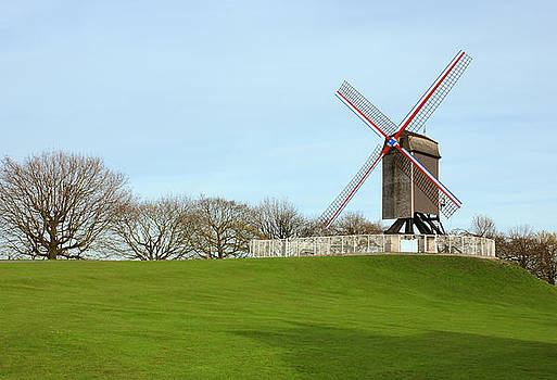 Windmill in the park in Bruges Belgium by Kiril Stanchev