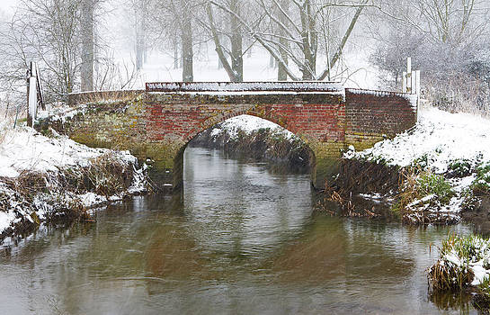 Fizzy Image - bridge over river in a snowstorm
