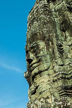 Carved face at Bayon Temple Angkor Cambodia by Fototrav Print