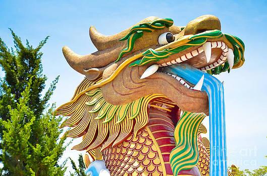 Dragon Ceramic decorate at the top at Pagoda by Keerati Preechanugoon