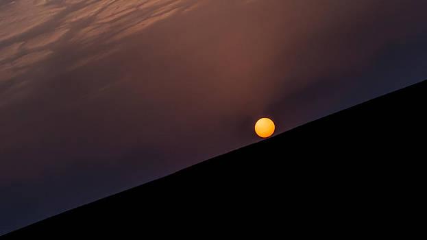 Falling sun by Girish Veetil