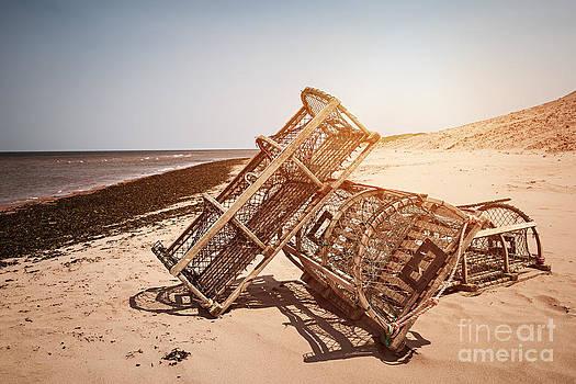 Elena Elisseeva - Lobster traps on beach
