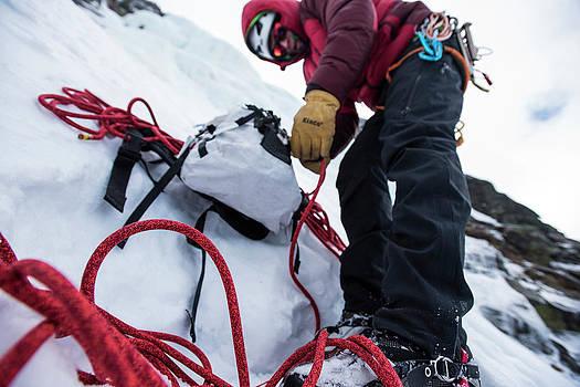 Man Preparing Ropes Before Climbing by Joe Klementovich