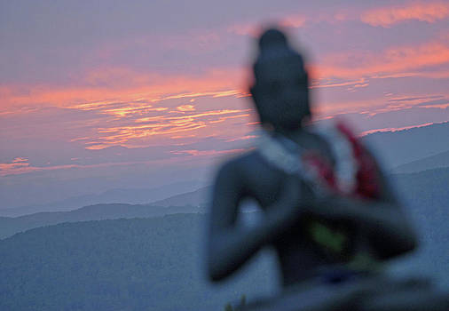 Buddha statue at sunset by Nano Calvo