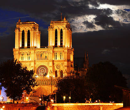 Notre Dame Cathedral in Paris France after sunset by T Monticello