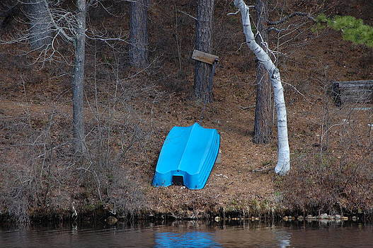 Overturned Blue Boat with Water Reflection by Richard Ballo