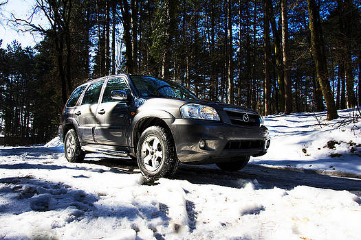 Newnow Photography By Vera Cepic - Right front side of Mazda Tribute on the mountain road