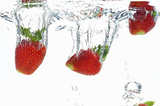 Strawberries fruits underwater by Sami Sarkis