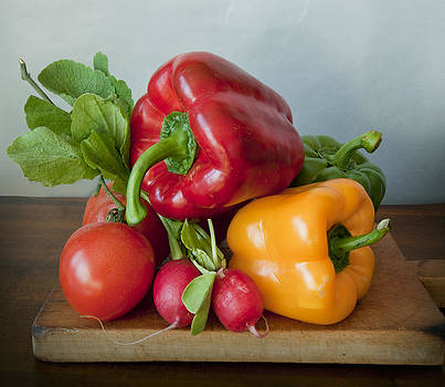 Summer vegetables on chopping board by Luisa Vallon Fumi