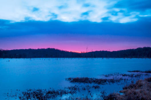 Sunrise over Blue Springs Lake by Clay Swatzell