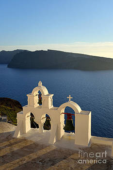 George Atsametakis - Sunset behind a belfry in Santorini island