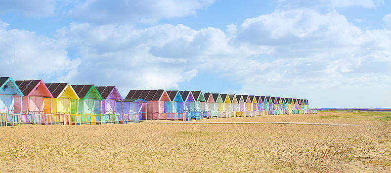 Fizzy Image - Traditional British beach huts at Maldon Essex on a bright sunny day