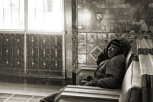 Young man sleeping in a chair at Union Station in Los Angeles by Kim M Smith
