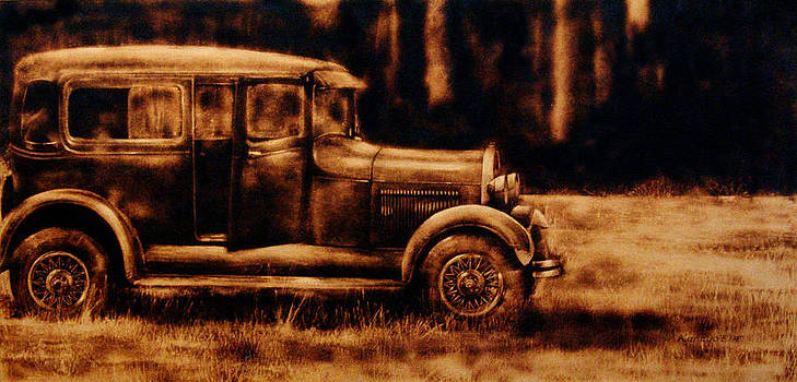 1929 - Burnt wood deep etching of an antique car by Kanayo Ede