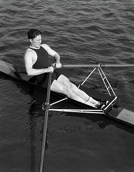 1930s Man Rowing Sculling Pulling Oars by Vintage Images