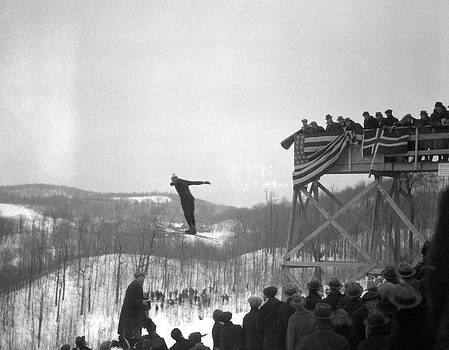 1930s Man Ski Jumping In Mid Air Crowd by Vintage Images