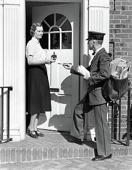 1930s Postman Giving A Letter by Vintage Images