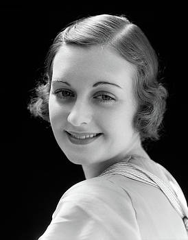 1930s Smiling Young Woman Head Turned by Vintage Images