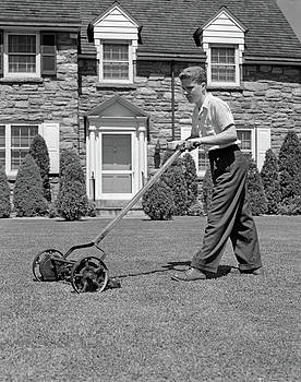 1940s Teenage Boy Mowing Grass Pushing by Vintage Images