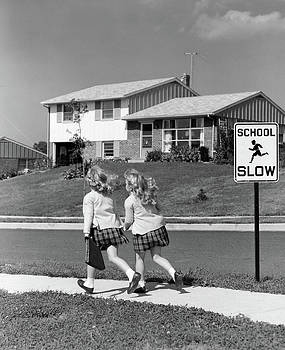 1950s Back View Of Twin Girls In Plaid by Vintage Images
