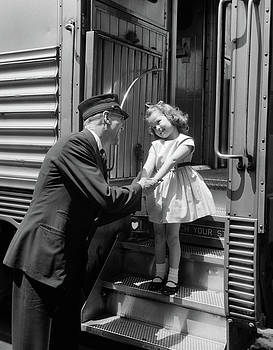 1950s Conductor Greeting Little Girl by Vintage Images