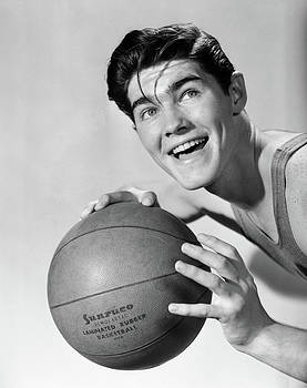 1950s Smiling Boy Holding Basketball by Vintage Images