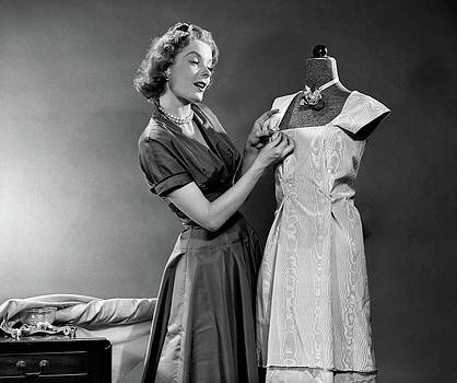 1950s Woman Making Dress Pinning Fabric by Vintage Images