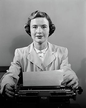1950s Woman Secretary Seated At Desk by Vintage Images