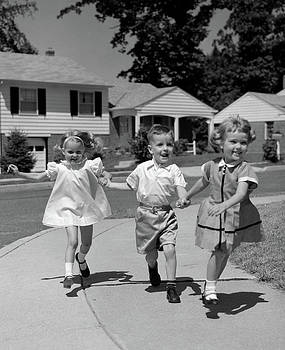 1960s 3 Kids Walking Skipping Running by Vintage Images