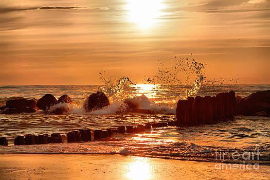 Beach sunset by Monika Wisniewska