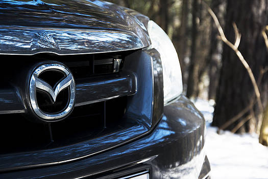 Newnow Photography By Vera Cepic - Closeup of Mazda car trademark