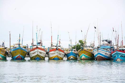Fishing boats in Tangalle port by Christina Rahm