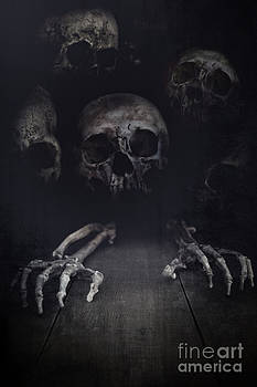 Sandra Cunningham - Skeletal hands and skulls creeping out from the dark