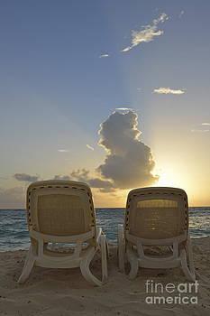 Sun lounger on tropical beach by Sami Sarkis
