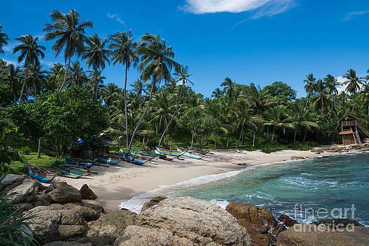 Tropical rocky beach by Christina Rahm