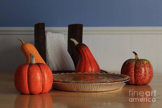 Christmas Pumpkin Pie with Napkin's and mini pumpkin's by Robert D  Brozek