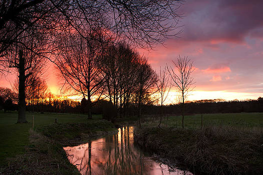 Fizzy Image - river flowing through an english countryside scene at sunset