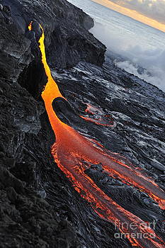 River of molten lava flowing to the ocean by Sami Sarkis
