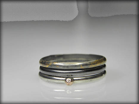 3 stacking silver rings with 14K and 24K gold by Vesna Kolobaric