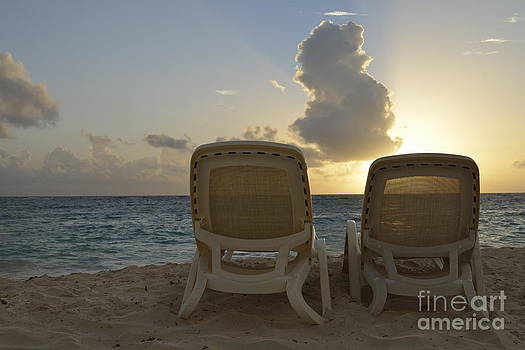 Sun lounger on tropical beach by Sami Sarkis