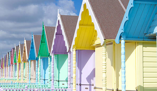 Fizzy Image - Traditional British beach huts on a bright sunny day