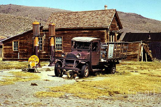 California Views Mr Pat Hathaway Archives - A 1927 Dodge Graham sits next gas pumps at Bodie State Historic Park California 1971