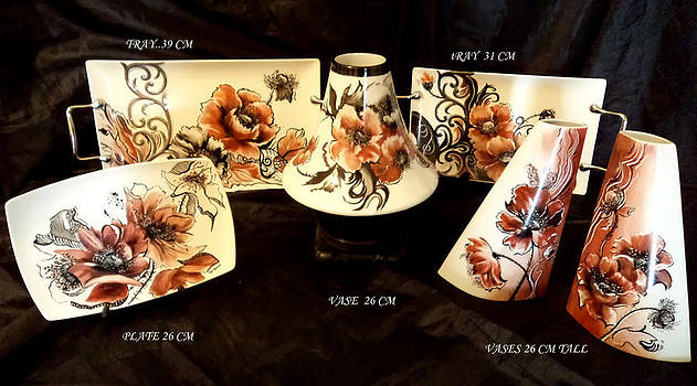 A collection of Porcelain with poppies by Patricia Rachidi
