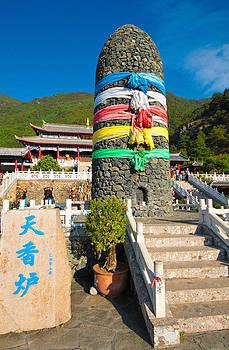 A large furnace at Jade Water Village at Lijiang Yunnan China by Calvin Chan
