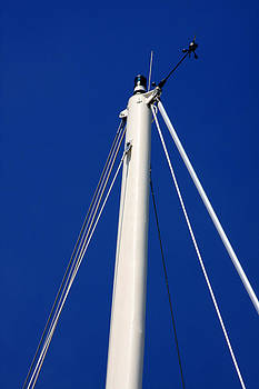 A White Mast Against an Azure Sky by Dana Moos