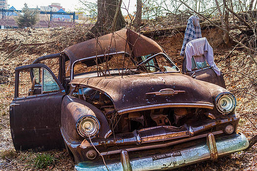 Abandon car becomes shelter by Frank White